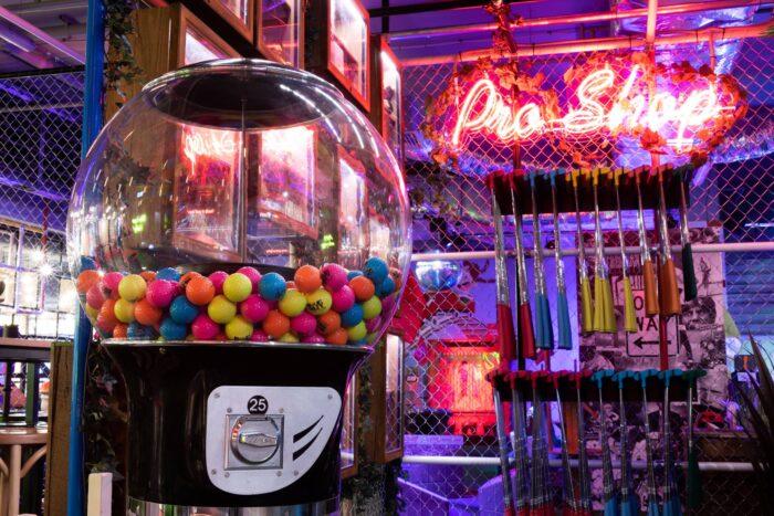 Mini golf clubs and balls at Holey Moley Wollongong.