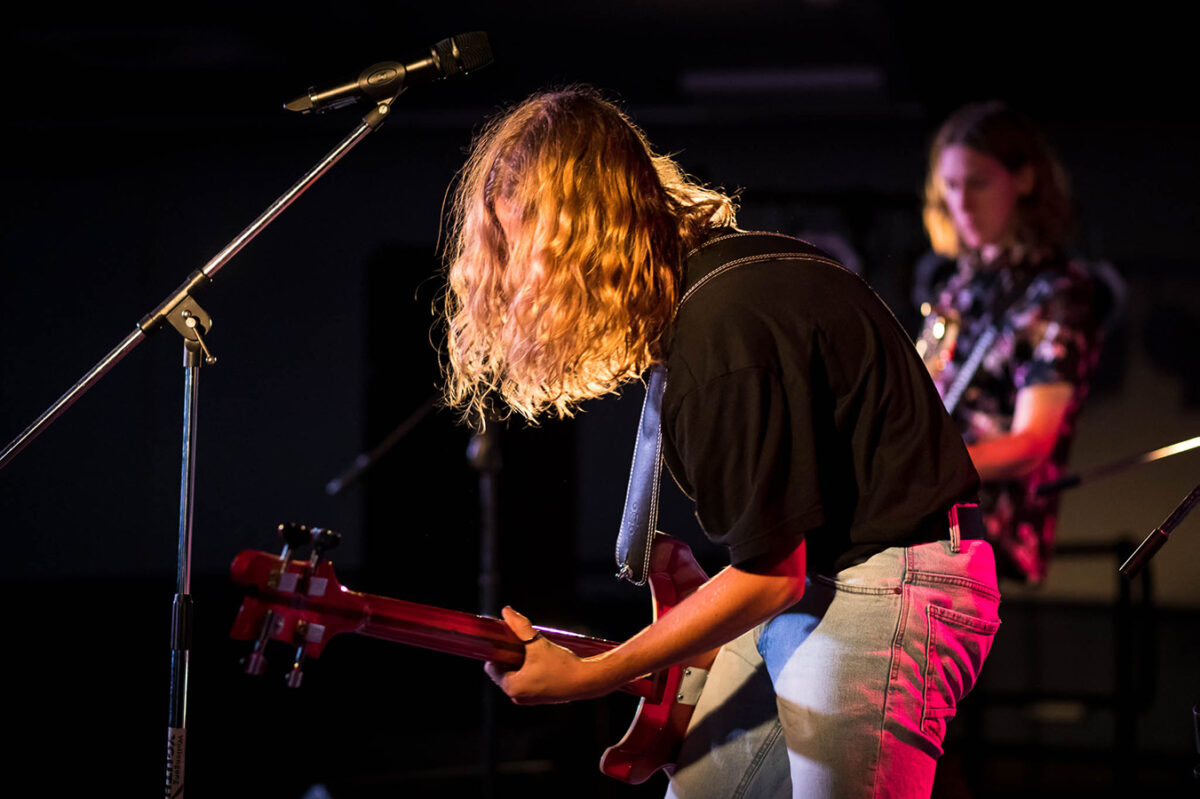 A guitar player on the stage of Wollongong youth Centre.
